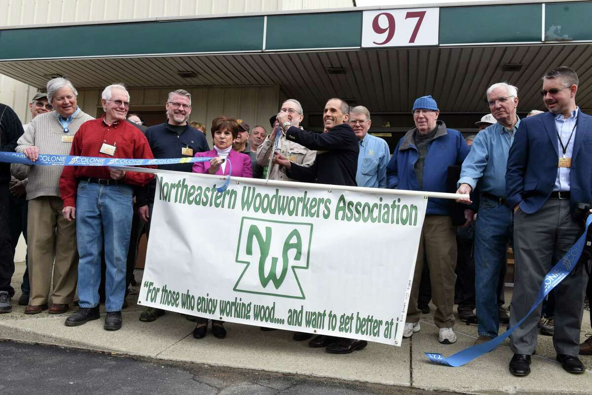 A ribbon is cut marking the opening of the Northeastern Woodworkers Association's new education center on Wednesday, Jan. 15, 2020, on Railroad Avenue in Colonie, N.Y. (Will Waldron/Times Union)