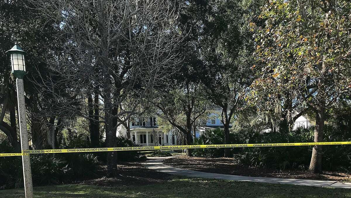 The white, two-story house where Anthony and Megan Todt lived with their three children remained a crime scene Tuesday, Jan. 14, 2020, the day after four bodies were found inside. Authorities have not publicly identified the deceased. (Grace Toohey/Orlando Sentinel/TNS)