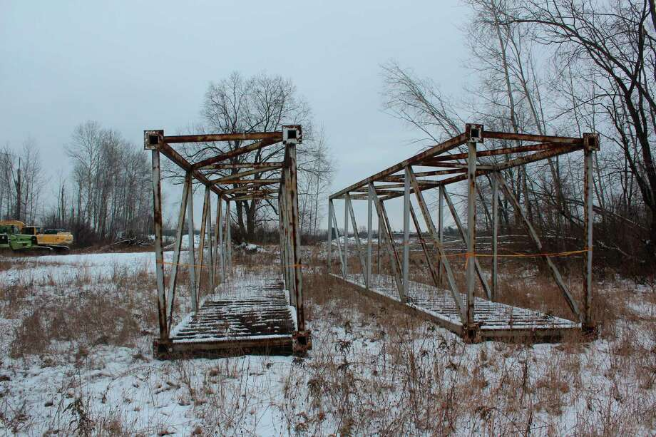 The walking bridge currently is being stored by Switzer Sand and Gravel near the township hall. It has been there since it was purchased in October 2018. (Pioneer photo/Catherine Sweeney)