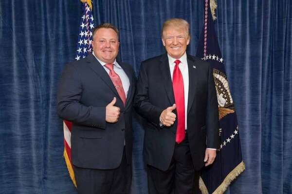 Robert F. Hyde, left, of Simsbury, shown here with President Donald Trump, has emerged as an unlikely participant on the periphery of the Trump impeachment scandal.