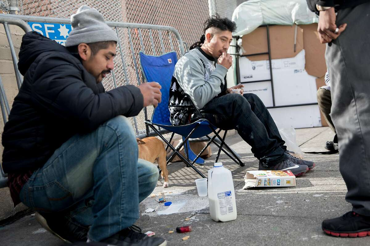 A group of homeless men (no names given) hang out near their tent spaces along Willow Street in San Francisco, Calif. Wednesday, Jan. 15, 2020.