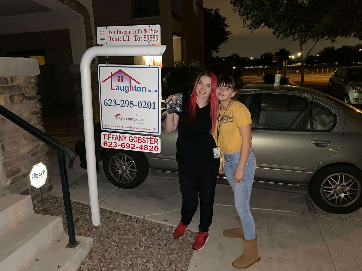 Crystal Chandler, left, and daughter Nevaeh Chappell celebrate the home they purchased on Dec. 4, 2019 in Phoenix, Arizona. Chandler and her daughter were on the brink of homelessness after losing their Concord apartment to an ownership change. They moved to Phoenix seeking more affordable rents and ended up learning they could actually afford to purchase a home.
