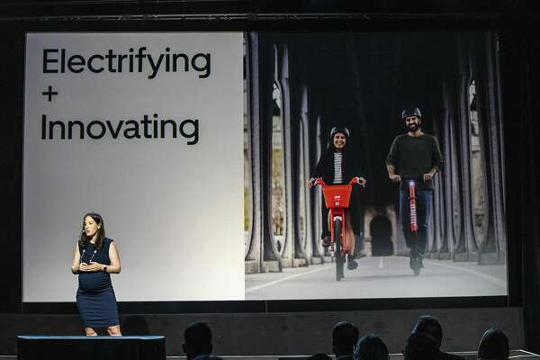 Uber Vice President of New Mobility Rachel Holt addresses the audience during an Uber products launch event in San Francisco, California, on September 26, 2019. - Uber on Thursday unveiled a new version of its smartphone app that weaves together services from shared rides to public transit schedules while adding more security features. The upgraded app is intended to let Uber users see, and ideally tap into, the company's array of options for getting around or having restaurant meals delivered. (Photo by Philip Pacheco / AFP) (Photo credit should read PHILIP PACHECO/AFP via Getty Images)