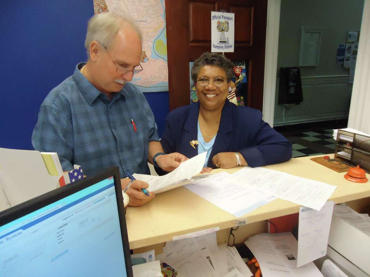 Stratford mayoral hopeful Stephanie Philips on Tuesday, August 8, 2017, turned in her petitions to get on the Sept. 12 Democratic primary ballot. Checking over the petition forms is Democratic Registrars of Voters Rick Marcone.