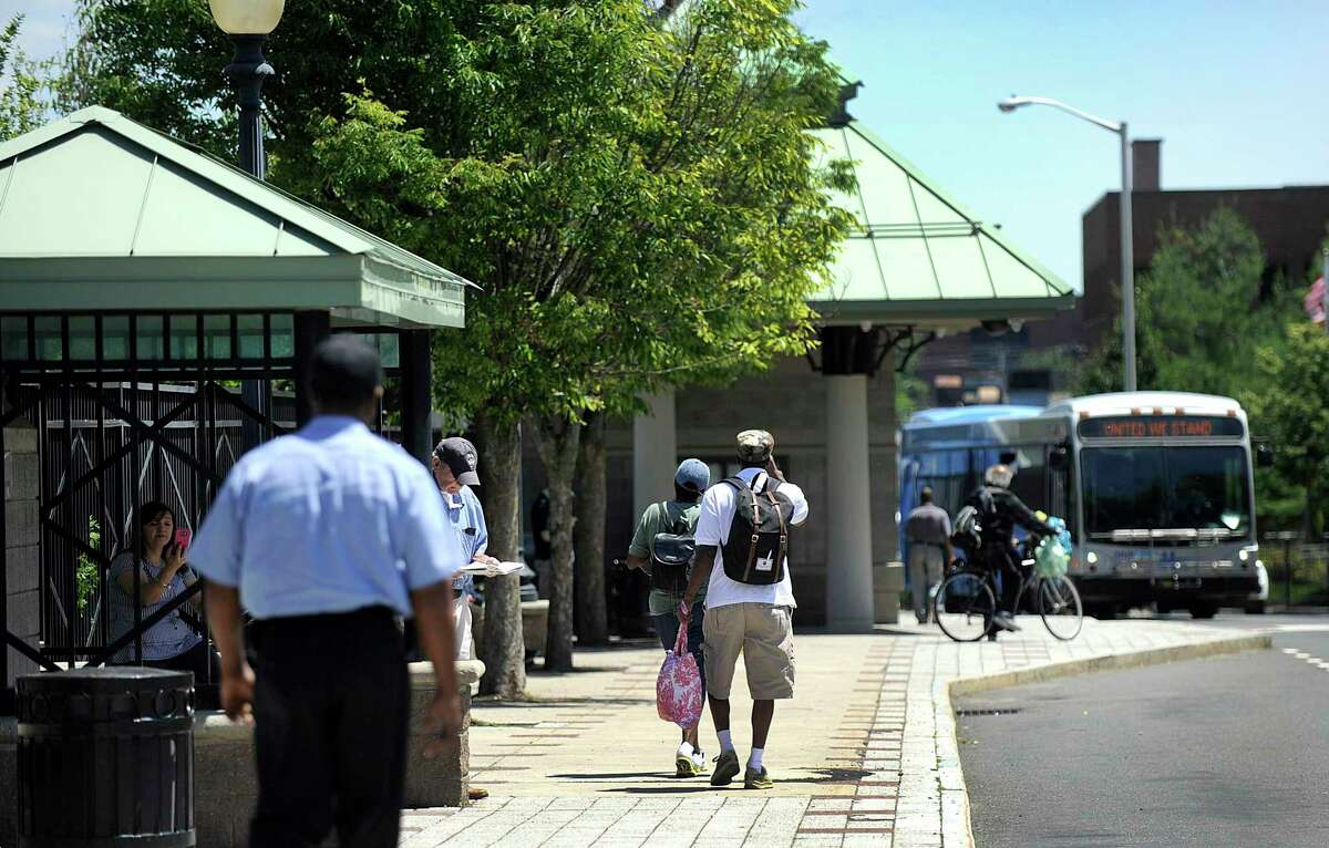 Passengers wait for buses at the HARTransit hub on Kennedy Avenue in Danbury Monday, June 25, 2018. Danbury received $2 million in grants from the state to support its plan to revitalize the the area of downtown around the train and bus stations.