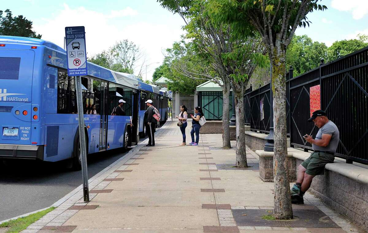 Passengers board buses at the HARTransit hub on Kennedy Avenue in Danbury Monday, June 25, 2018. Danbury received $2 million in grants from the state to support its plan to revitalize the the area of downtown around the train and bus stations.