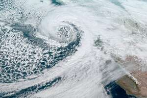 Meteorologists shared satellite imagery of a potent winter storm headed for the West Coast.