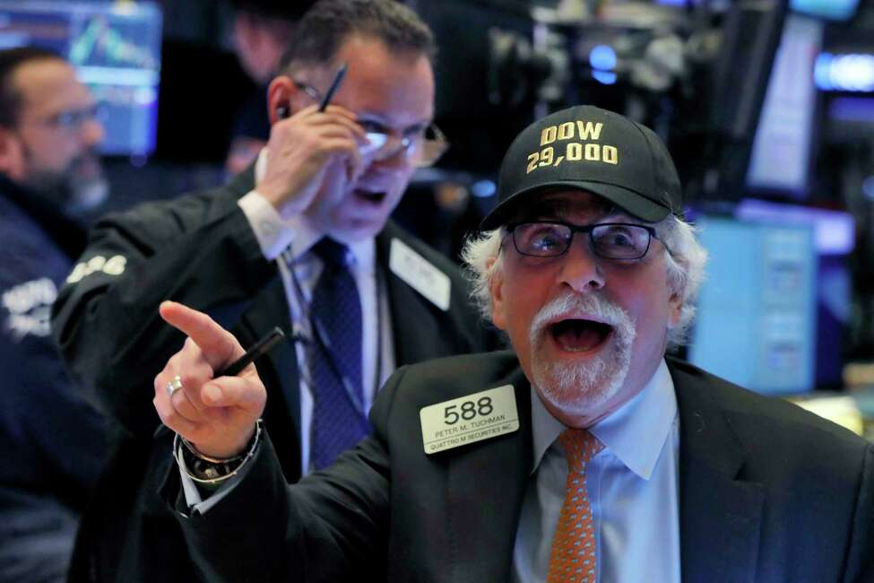 Trader Peter Tuchman wears his
