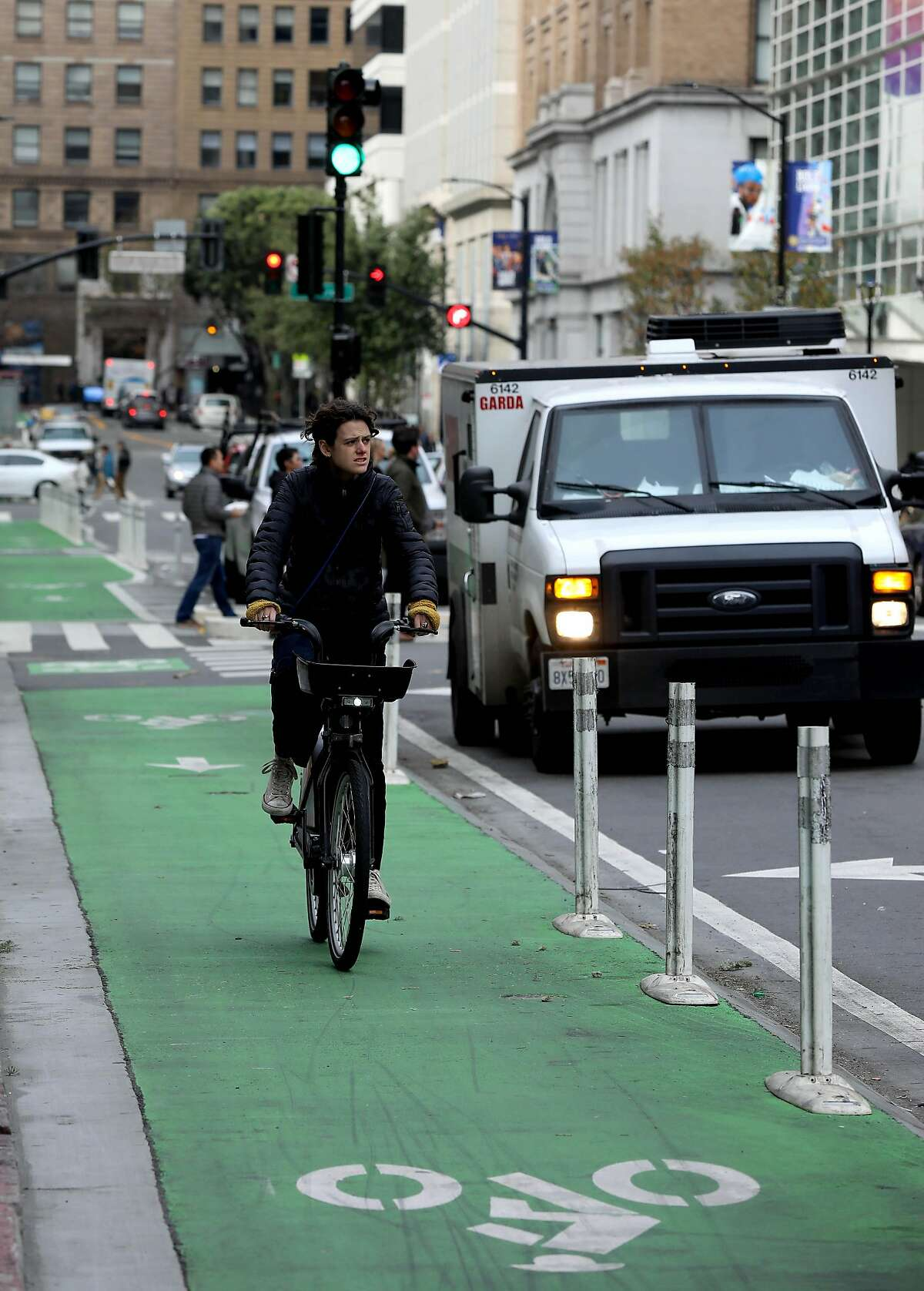 A cyclist travels in the bike lane near Howard and Second, in San Francisco, Calif., on Wednesday, January 15, 2020.