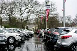 Vehicles sit on display for sale at a Nissan Motor Co. car dealership in Patchogue, New York, U.S., on Friday, April 27, 2018. WARD's Automotive Group is scheduled to release auto sales figures on May 1. Photographer: Johnny Milano/Bloomberg
