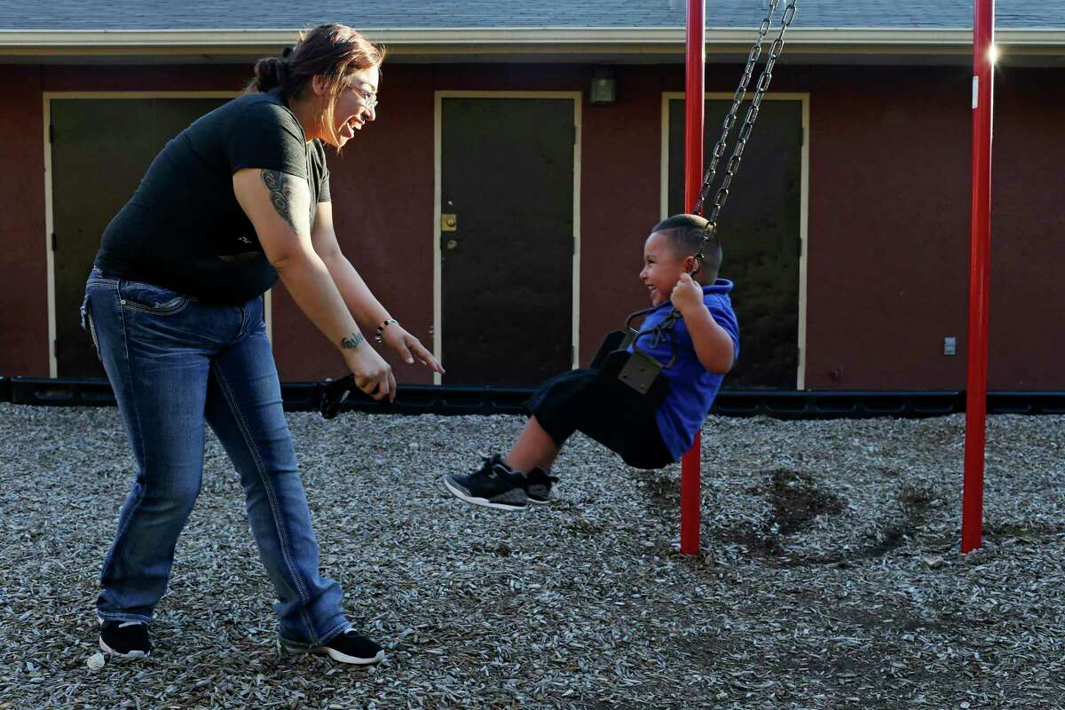 Stacy Tello, 25, plays with her son, Xavier Barrientes, 3, at their Sutton Drive apartment, Dec. 12, 2017. Tello, a single mother of four, relies on two jobs and food handouts to make ends meet. There are direct links from poverty, iliteracy and crime in San Antonio to fatherless homes. During the next decade, the city must focus on the importance of families.