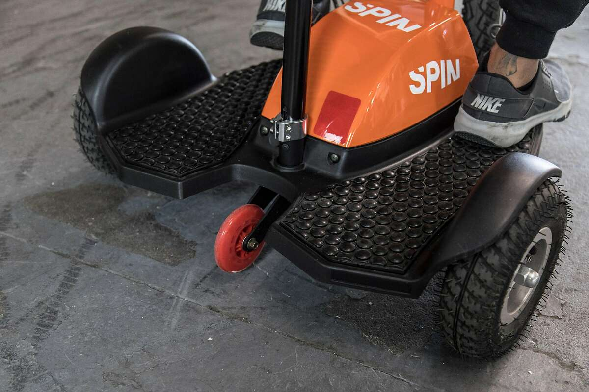 Spin is one of the electric scooter companies that have rolled out new accesibility scooters designed for people with disabilities. The Spin model has three wheels and a seat.