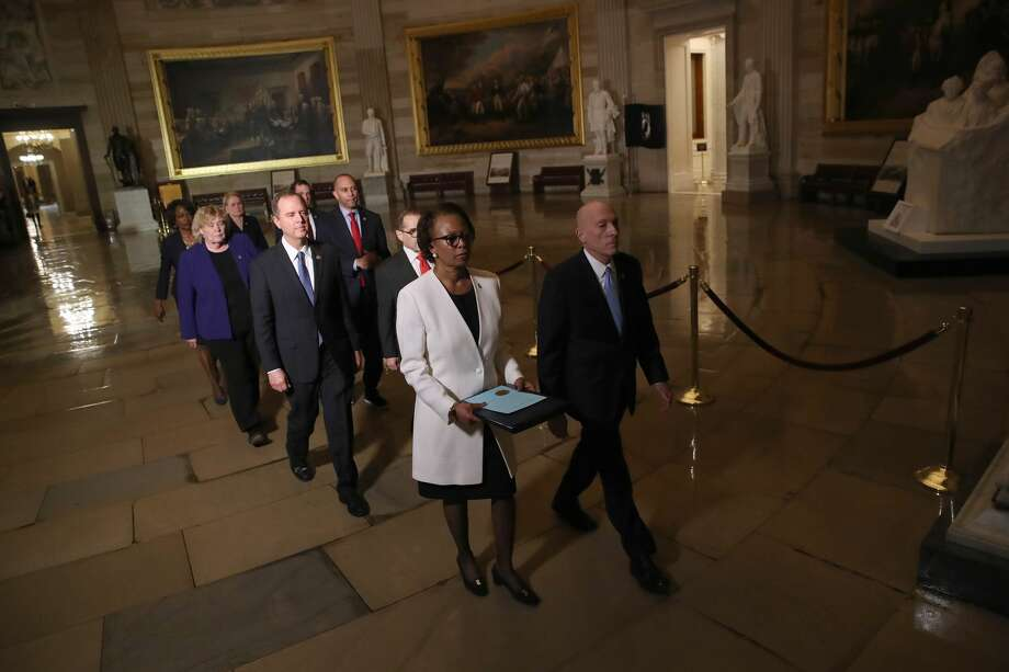 Articles of Impeachment against U.S. President Donald Trump are formally carried through the Rotunda of the U.S. Capitol by officials from the U.S. House of Representatives to the U.S. Senate on January 15, 2020 in Washington, DC. The impeachment trial in the Senate is expected to begin early next week. Carrying the articles of impeachment is Clerk of the House of Representatives Cheryl Johnson accompanied by House Sergeant of Arms Paul Irving and managers appointed by Speaker of the House Nancy Pelosi including Rep. Adam Schiff (D-CA), Rep. Jerry Nadler (D-NY), Rep. Zoe Lofgren (D-CA), Rep. Hakeem Jeffries (D-NY), Rep. Val Demings (D-FL), Rep. Jason Crow (D-CO) and Rep. Sylvia Garcia (D-TX). Photo: Win McNamee/Getty Images