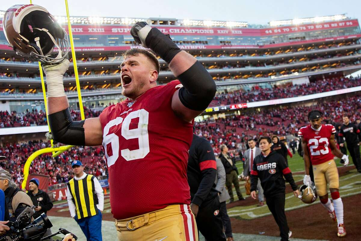 San Francisco 49ers offensive tackle Mike McGlinchey (69) gestures towards fans following their win in the NFC Divisional Round playoff game against the Minnesota Vikings at Levi's Stadium on Saturday, Jan. 11, 2020, in Santa Clara, Calif. The 49ers won 27-10.