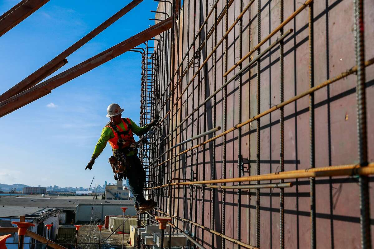 Ironworker Isaac Guzman works on a construction site that will be the parking lot for a new condo building at Alameda Point on Tuesday, Jan. 14, 2020 in Alameda, California.