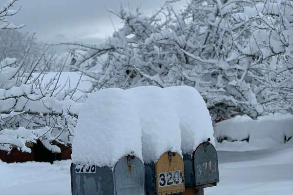 Over 23 inches of snow sits precariously on mailboxes in Port Angeles, Washington on Jan. 15, 2020. The city on the Olympic Peninsula was expected to get more throughout the evening.