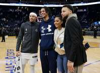 Stephen Curry (30), right, poses for a photo with (l-r) his brother, Seth Curry, brother-in-law Damion Lee, and sister Sydel Curry-Lee, after the Golden State Warriors played the Dallas Mavericks at Chase Center in San Francisco, Calif., on Tuesday, January 14, 2020.