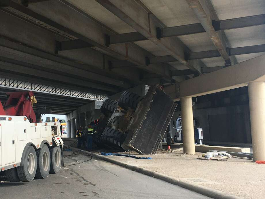 Crews were still trying to remove a loader from the crash scene and assess structural damage at Loop 1604 & Pat Booker Road. Photo: TxDOT San Antonio Twitter