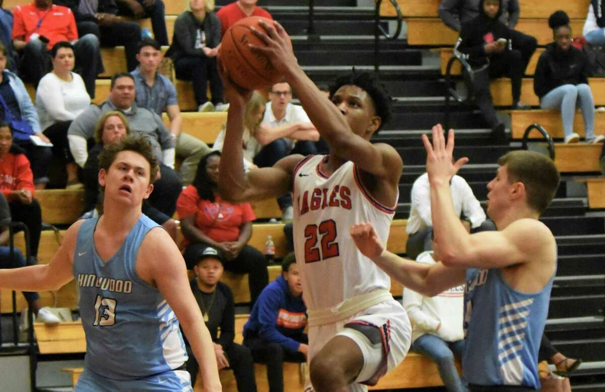 Atascocita's Cameron Morrison drives the lane for a basket against Kingwood in a District 22-6A game.