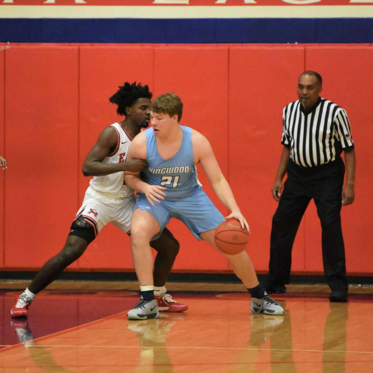 Kingwood's Nick Neuman battles in the post with Atascocita's Dylan Robinson in a District 22-6A game.