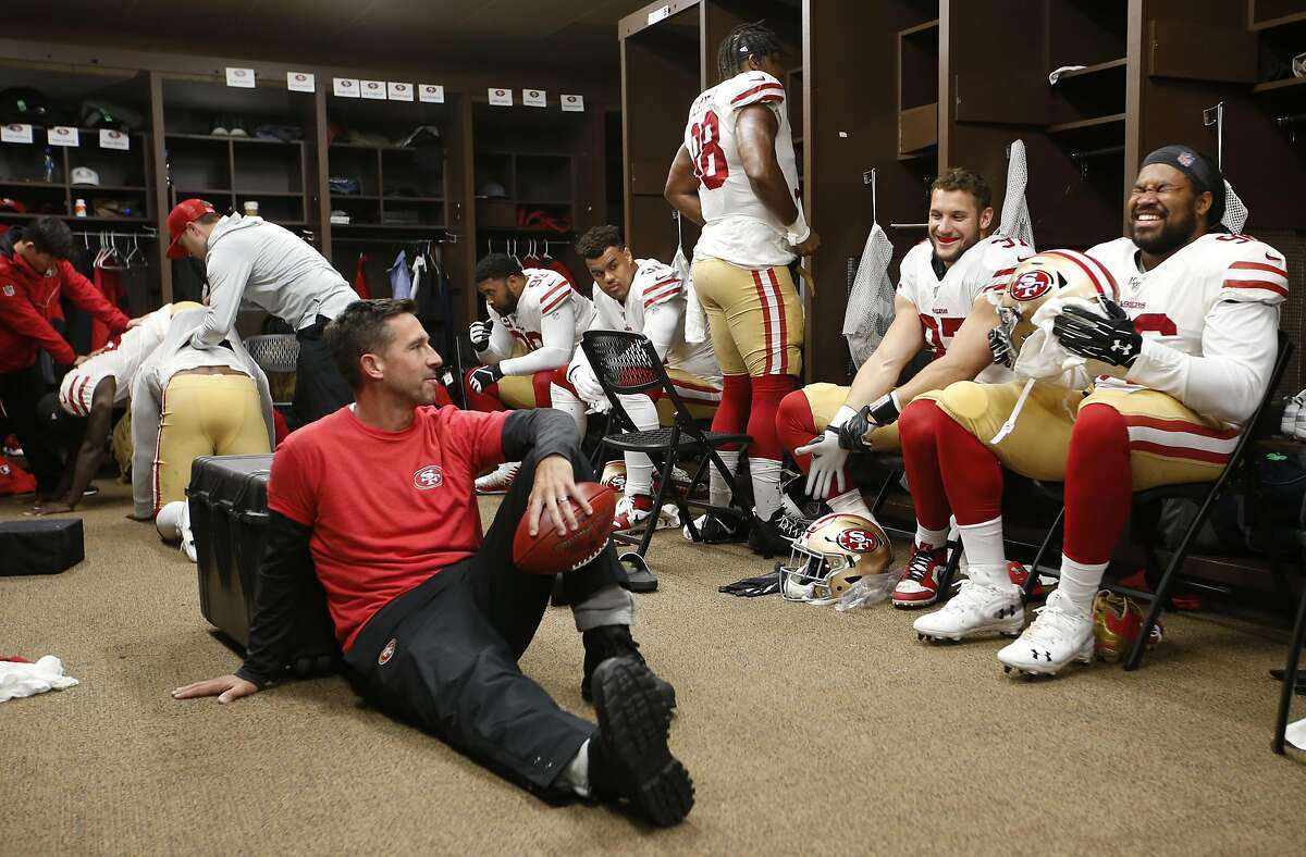 LANDOVER, MD - OCTOBER 20: Head Coach Kyle Shanahan of the San Francisco 49ers talks with Nick Bosa #97 and Sheldon Day #96 in the locker room prior to the game against the Washington Redskins at FedExField on October 20, 2019 in Landover, Maryland. The 4