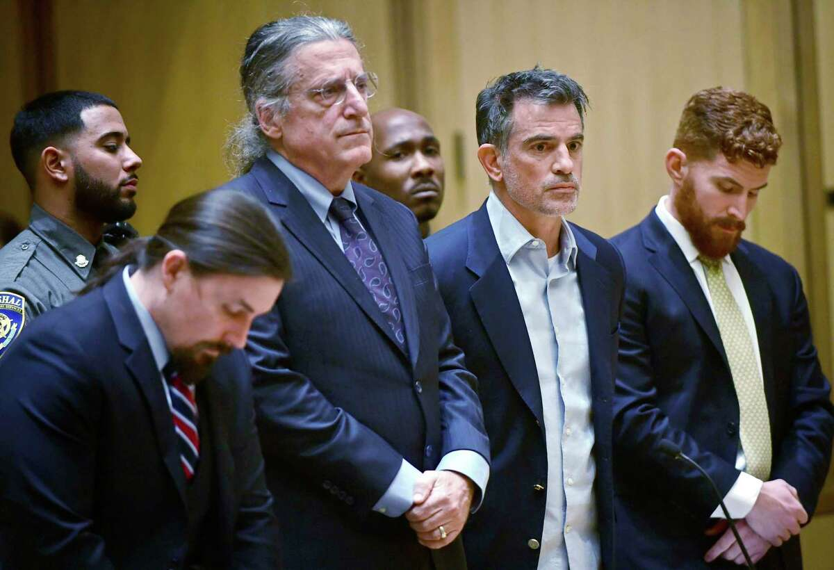 Fotis Dulos, third from left, the estranged husband of Jennifer Dulos, a missing mother of five, is arraigned on murder and kidnapping charges in Stamford Superior Court Wednesday, Jan. 8, 2020, in Stamford, Conn.