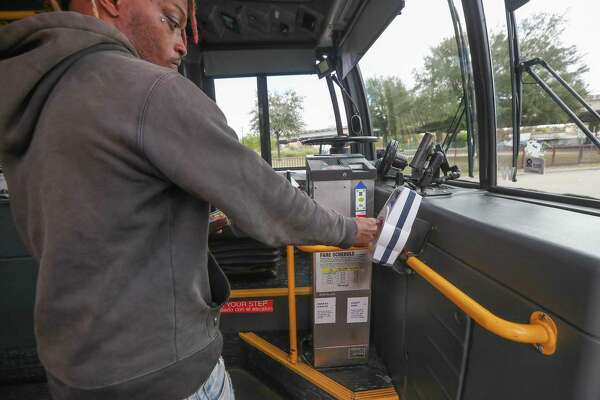 Metropolitan Transit Authority bus riders use Q cards, smartphone apps or cash to hop aboard on Nov. 20, 2019, in Houston. Officials on Wednesday balked at the cost of eliminating fares for riders.