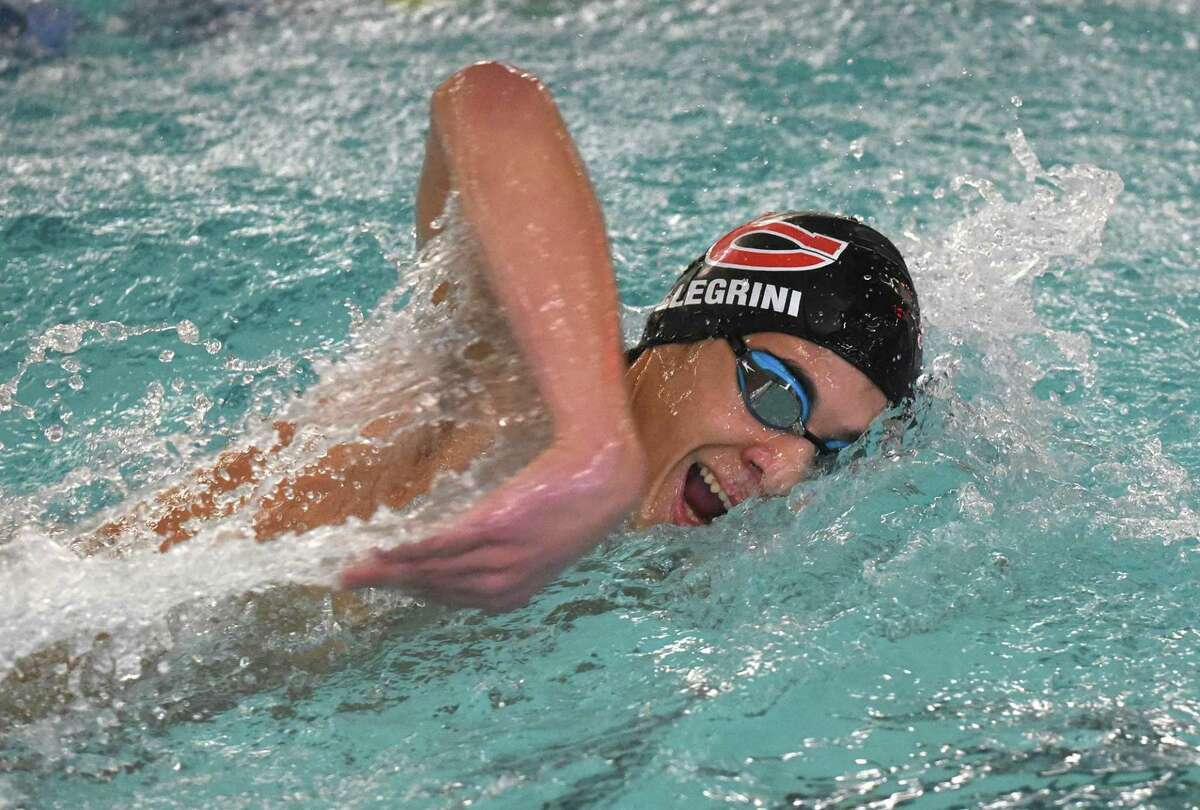New Canaan's Sumner Pellegrini swims in the 400 freestyle relay during the Wave's swim meet against Darien at the Darien YMCA on Wednesday, Jan. 15, 2020.