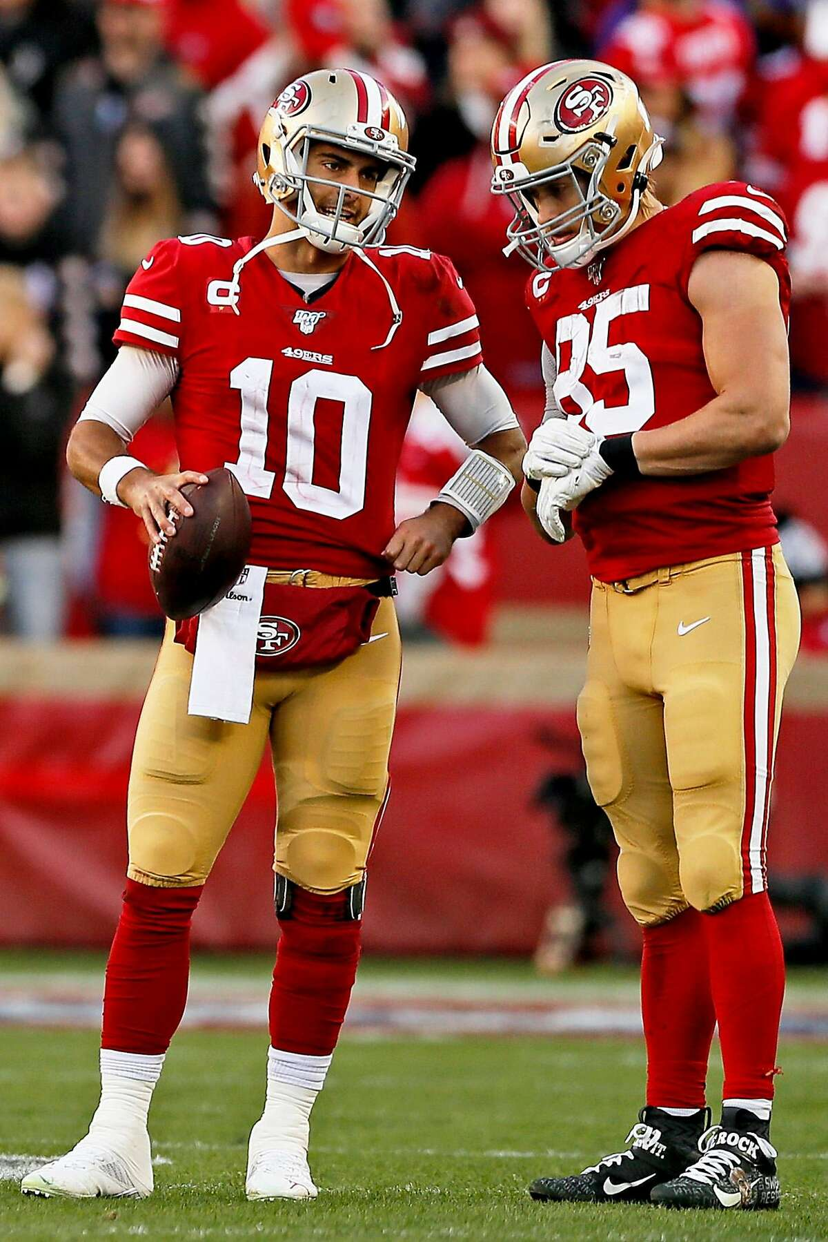 San Francisco 49ers quarterback Jimmy Garoppolo (10) talks to 49ers tight end George Kittle (85) as Garoppolo warms up with 49ers wide receiver Kendrick Bourne (84) in the second half of an NFC Divisional Round playoff game against the Minnesota Vikings, Saturday, Jan. 11, 2020, in Santa Clara, Calif. The 49ers won 27-10.