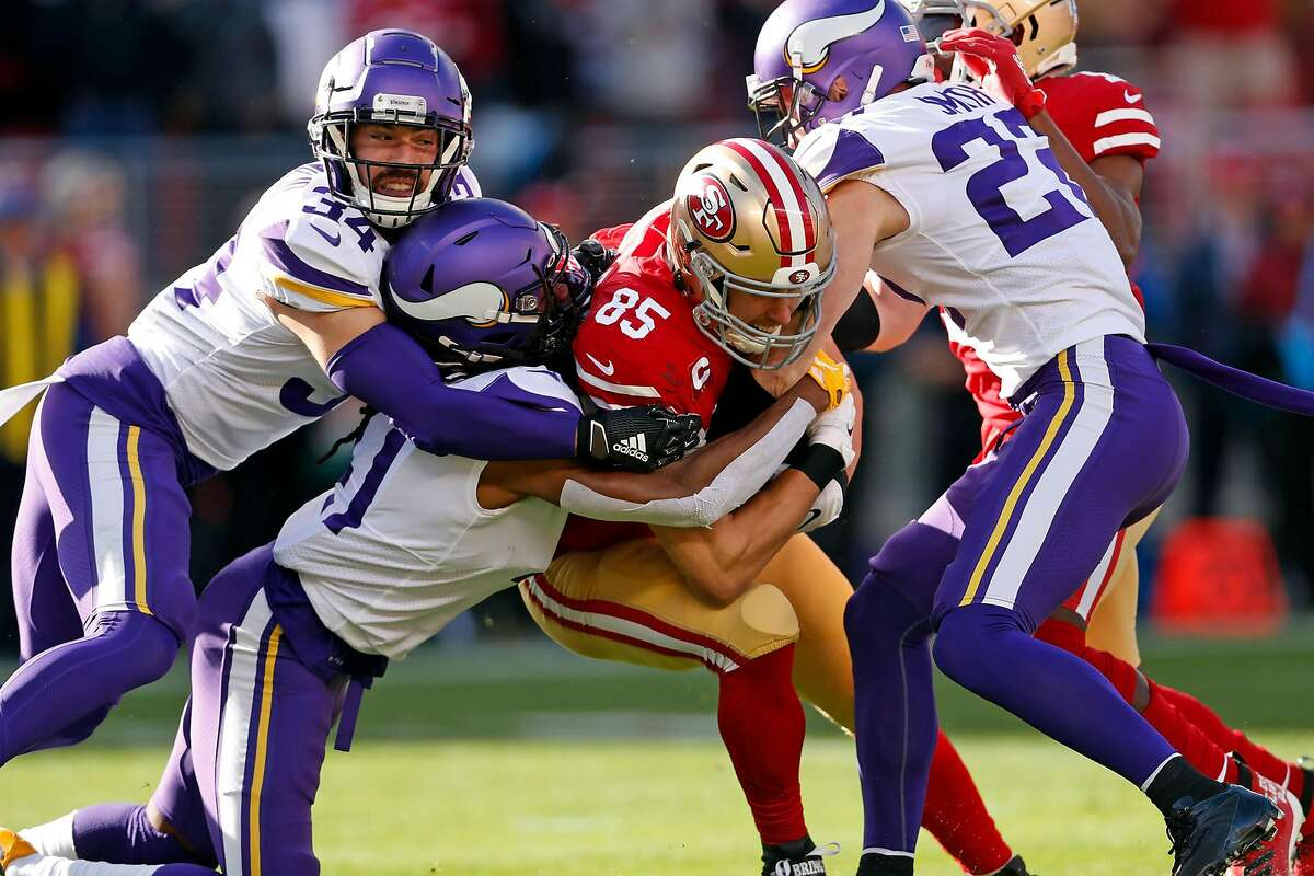 San Francisco 49ers' George Kittle is brought down by three Minnesota Vikings in 1st quarter during NFC Divisional playoff game at Levi's Stadium in Santa Clara, Calif., on Saturday, January 11, 2020.