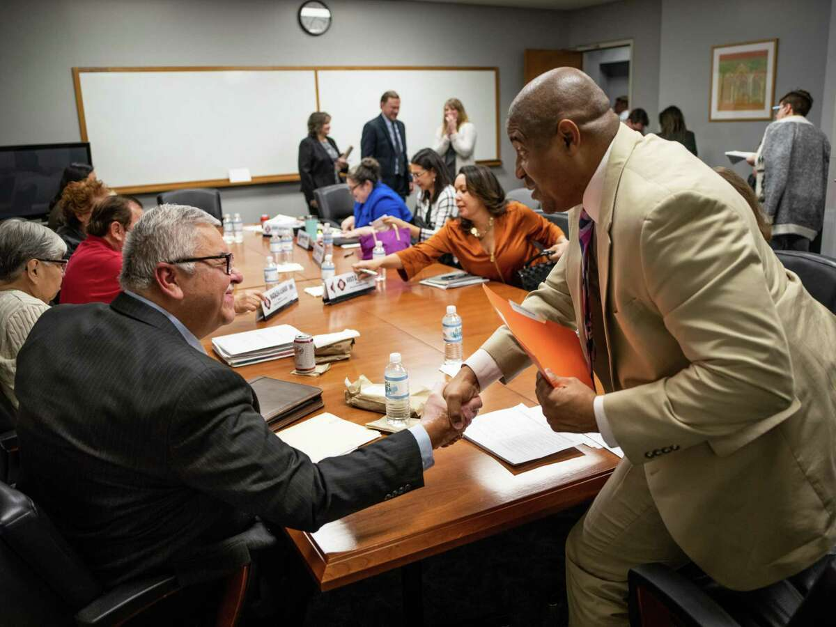 A meeting of the San Antonio Ethics Review Board ends with a handshake between board member Ruben De Leon, left, and the board's chair, Patrick Lang, right, on December 3, 2019. The City Council's Governance Committee on Wednesday voted unanimously to send a proposed set of changes to the city's Ethics Code to the board for its consideration.