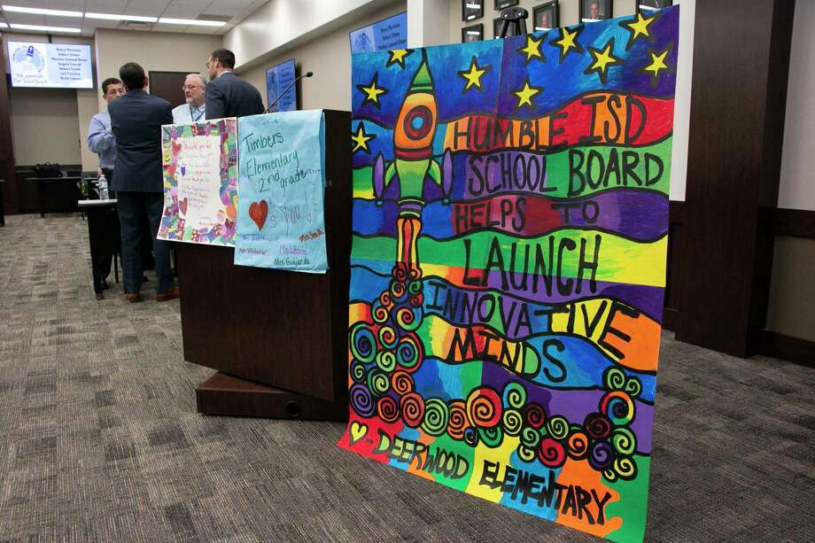 "The Humble ISD School Board held its first meeting of the school year on Jan. 14. Kingwood High School art students, taught by Melissa Frye, used the school board recognition month theme ""Launching the Next Generation"" to create a caricature of each trustee that was presented to them at the meeting. Photo: Savannah Mehrtens/Staff Photo / Savannah Mehrtens/Staff Photo"