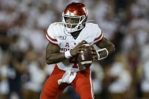 Houston Cougars quarterback D'Eriq King (4) looks for an open receiver during the third quarter of an NCAA game against the Oklahoma Sooners at Gaylord Memorial Stadium Sunday, Sept. 1, 2019, in Norman, Oklahoma. The Sooners won 49-31.
