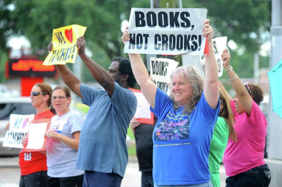 Several teachers and supporters gathered at Rogers Park to protest the possible Beaumont ISD layoffs directed at educators in this June 2014 photo. (Staff file photo)