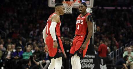 Houston Rockets' Russell Westbrook, left, celebrates with Danuel House Jr. (4) after Westbrook scored during the second half of the team's NBA basketball game against the Los Angeles Clippers on Thursday, Dec. 19, 2019, in Los Angeles. (AP Photo/Marcio Jose Sanchez)