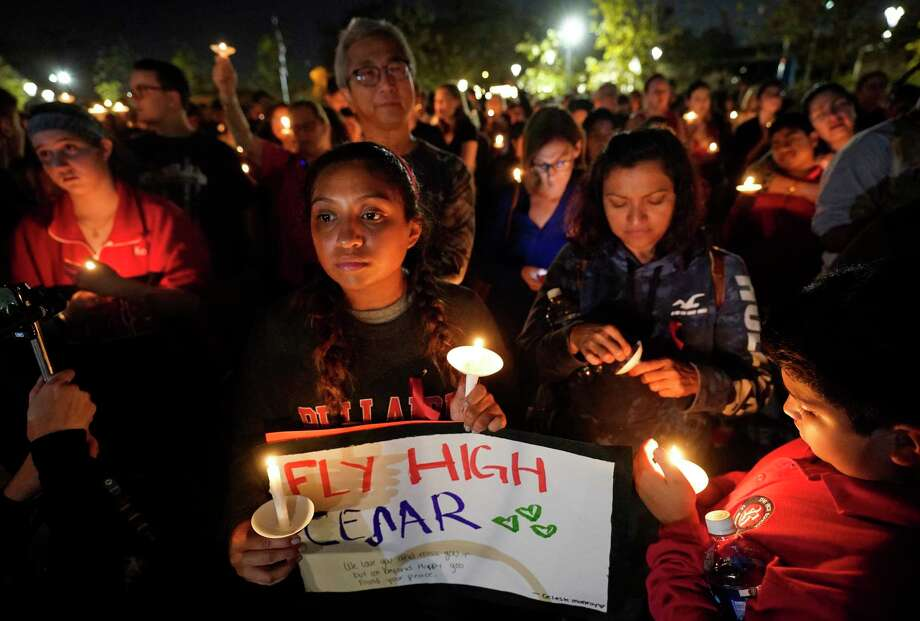Celeste Monroy, 16, a junior at Bellaire High School, holds a sign during a vigil for her schoolmate Cesar Cortes at Evelyn's Park in Bellaire Wednesday, Jan. 15, 2020. Cesar Cortes, 19, a Bellaire High School senior, died after being shot at the school yesterday. Cortes was killed in what officials described as an accidental shooting on campus by a fellow JROTC classmate. Photo: Melissa Phillip, Staff Photographer / © 2020 Houston Chronicle