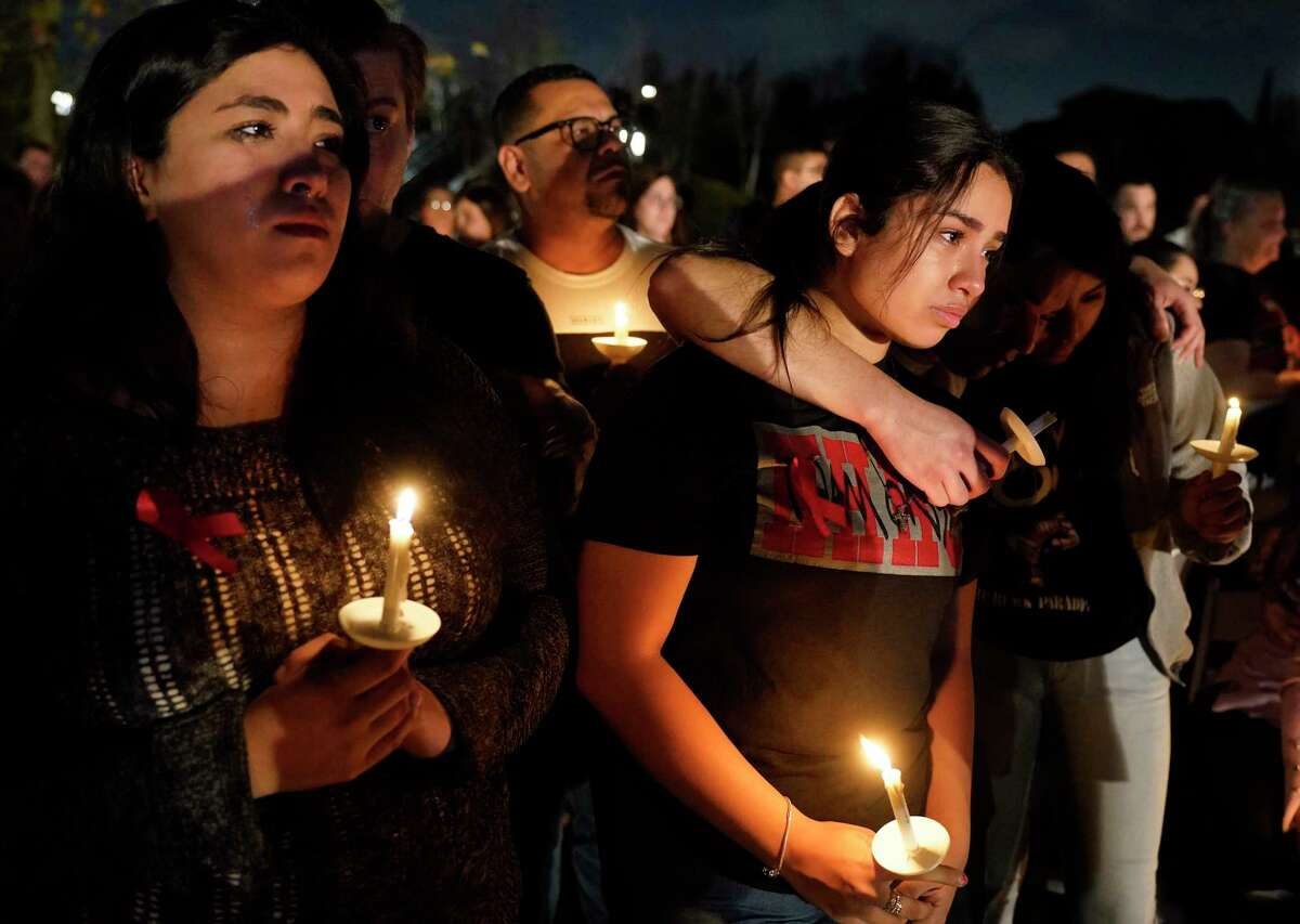 Yaxkin Rodirguez, left, and her sister, Cittlali Campos Diaz, second from left, attend a vigil for their cousin, Cesar Cortes, at Evelyn's Park in Bellaire Wednesday, Jan. 15, 2020. Cesar Cortes, 19, a Bellaire High School senior, died after being shot at the school yesterday. Cortes was killed in what officials described as an accidental shooting on campus by a fellow JROTC classmate.
