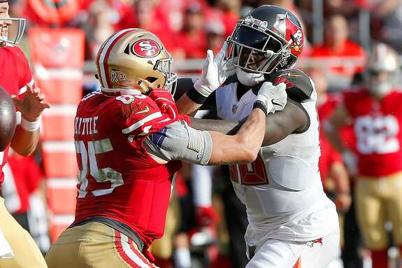 TAMPA, FL - NOV 25: George Kittle (85) of the 49ers blocks Jason Pierre-Paul (90) of the Bucs during the regular season game between the San Francisco 49ers and the Tampa Bay Buccaneers on November 25, 2018 at Raymond James Stadium in Tampa, Florida. (Photo by Cliff Welch/Icon Sportswire via Getty Images)