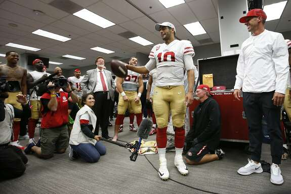 GLENDALE, AZ - OCTOBER 31: Jimmy Garoppolo #10 of the San Francisco 49ers addresses the team after being award the game ball in the locker room following the game against the Arizona Cardinals at State Farm Stadium on October 31, 2019 in Glendale, Arizona