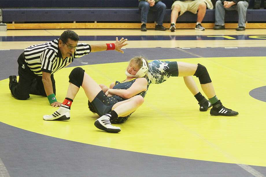 Manistee's Mercedez McLeod wrestles Mason County Central during the Chippewas' home opener on Wednesday. Photo: Kyle Kotecki/News Advocate
