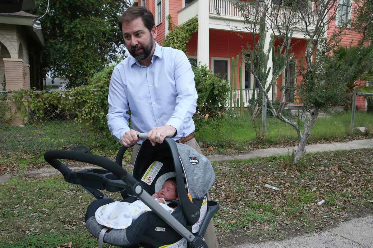 Alan Neff and his six-week-old son, Cruz, at their house on the 1300 block of Wyoming in the Denver Heights neighborhood in east San Antonio, Wednesday, Jan. 15, 2020. Neff and his wife bought the two-story house and worked on most of the renovations themselves.