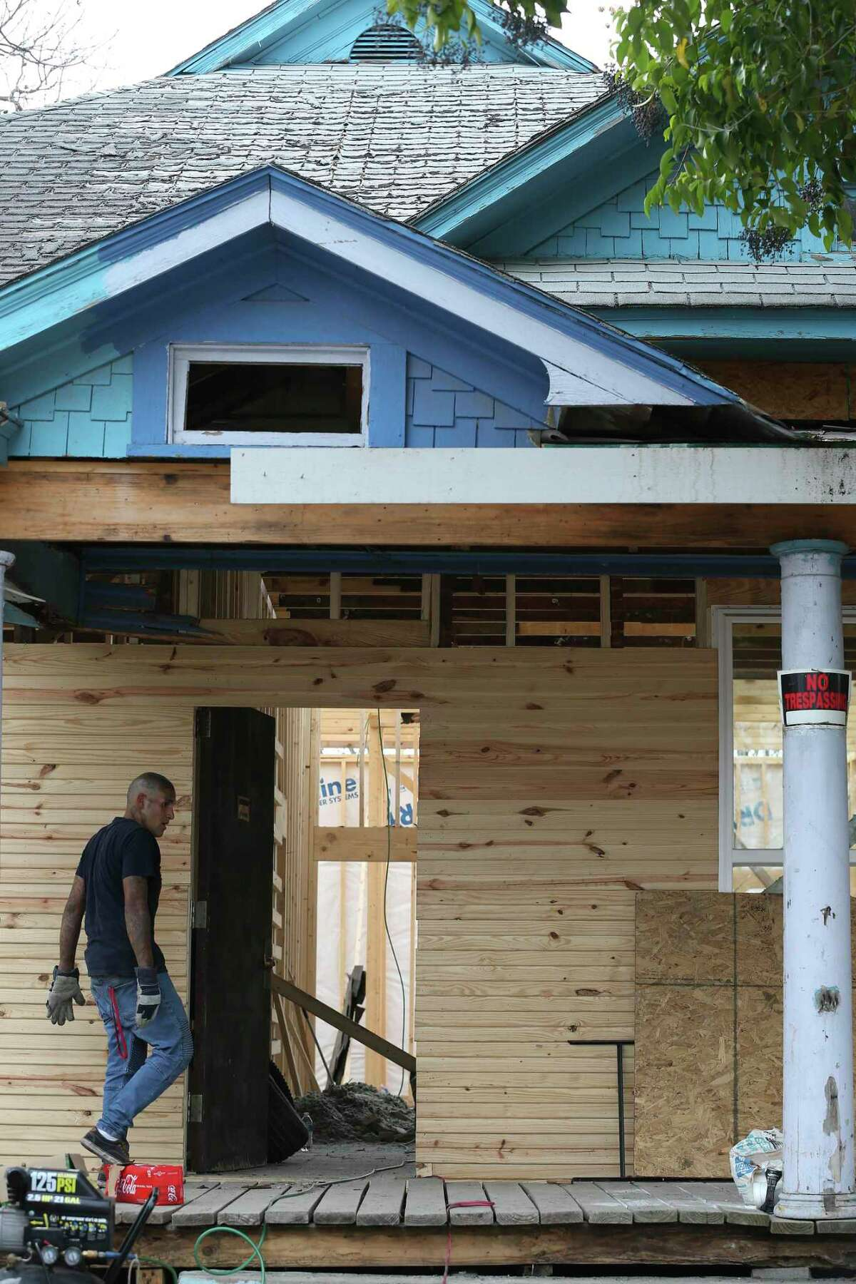Work continues at a house on the 300 block of Spruce in the Denver Heights neighborhood in east San Antonio, Wednesday, Jan. 15, 2020.