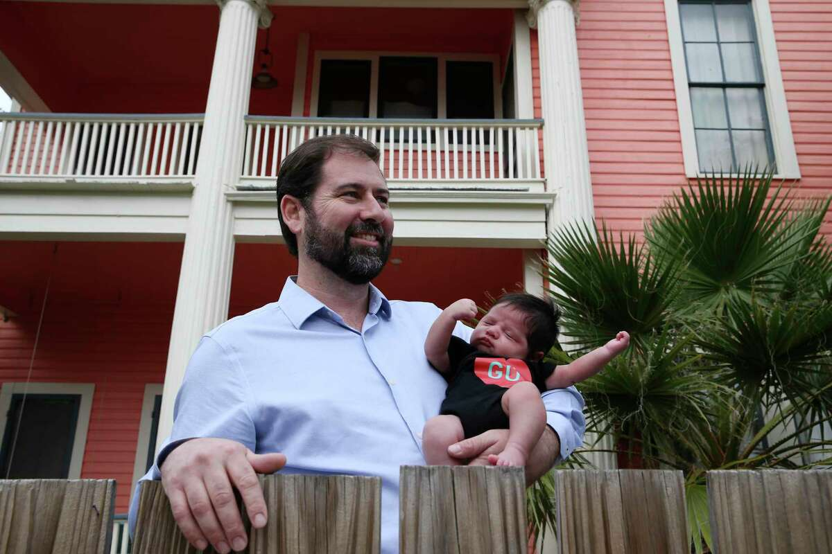 Alan Neff and his six-week-old son, Cruz, pose in front of their house on the 1300 block of Wyoming in the Denver Heights neighborhood in east San Antonio, Wednesday, Jan. 15, 2020.