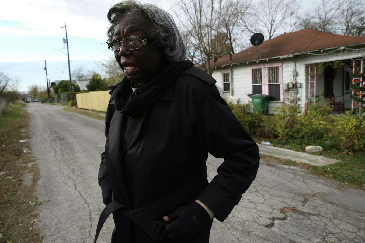 Grace Hill, 80, walks around Denver Heights on the East Side on Tuesday, Dec. 17, 2019. Hill inherited a house on the 700 block of Martin Luther King Drive, pictured in the background, from her foster parents.