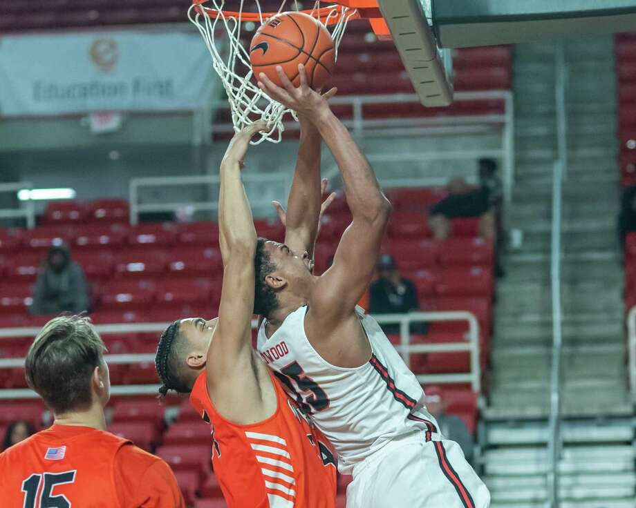 T.J. Atwood (15) stuffs one in up close in the first half as the Lamar Cardinals took on the Sam Houston State University Bearkats on Wednesday, January 15, 2020. Fran Ruchalski/The Enterprise Photo: Fran Ruchalski/The Enterprise / 2019 The Beaumont Enterprise