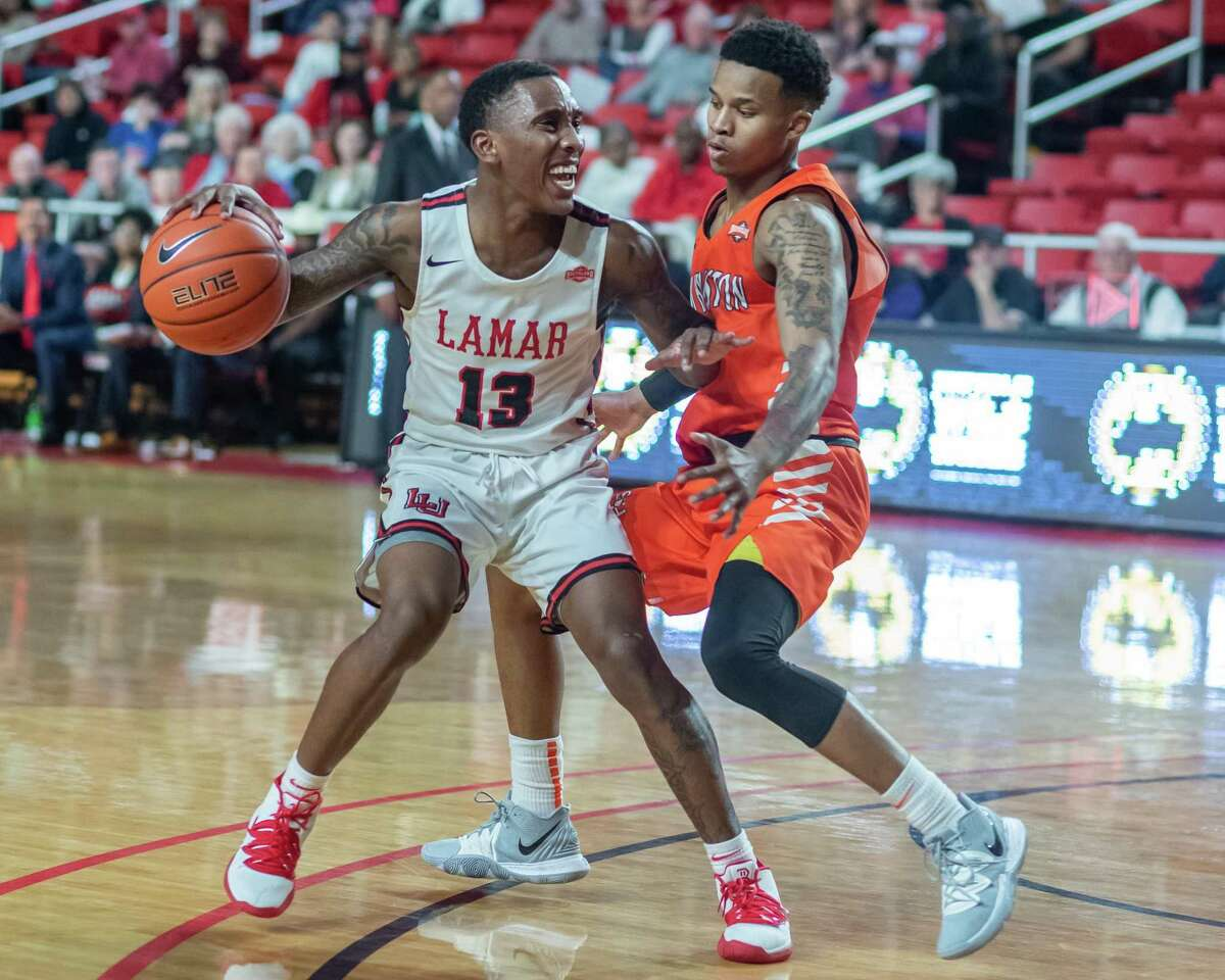 Davion Buster (13) dribbles around Chad Bowie (4) as the Lamar Cardinals took on the Sam Houston State University Bearkats on Wednesday, January 15, 2020. Fran Ruchalski/The Enterprise