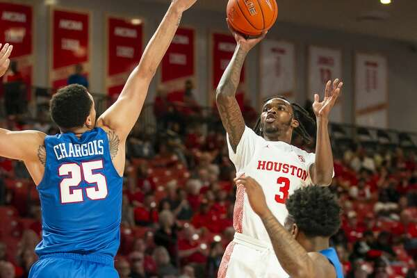 Houston Cougars guard DeJon Jarreau (3) shoots over Southern Methodist Mustangs forward Ethan Chargois (25) during the first half of the Cougars' game against the Mustangs at the Fertitta Center in Houston, Wednesday, Jan. 15, 2020.