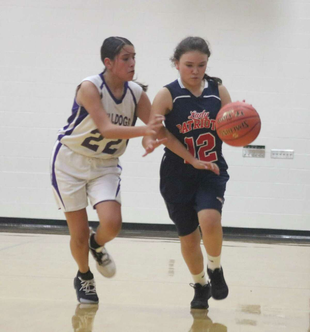 Southmore's Alazay Olivares (22) hounds Bondy's Felicity Artega as she works the ball up the court in Wednesday night's tournament game. Olivares scored all 16 of Southmore's points in the 31-16 final score.