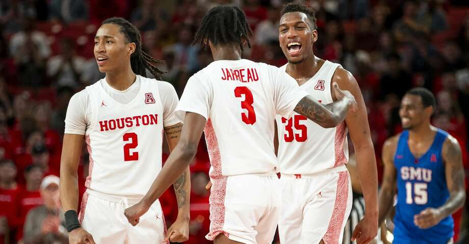 Houston Cougars guard Caleb Mills (2), guard DeJon Jarreau (3) and forward Fabian White Jr. (35) celebrate after a play during the second half of the Cougars' game against the Mustangs at the Fertitta Center in Houston, Wednesday, Jan. 15, 2020. Photo: Mark Mulligan/Staff Photographer