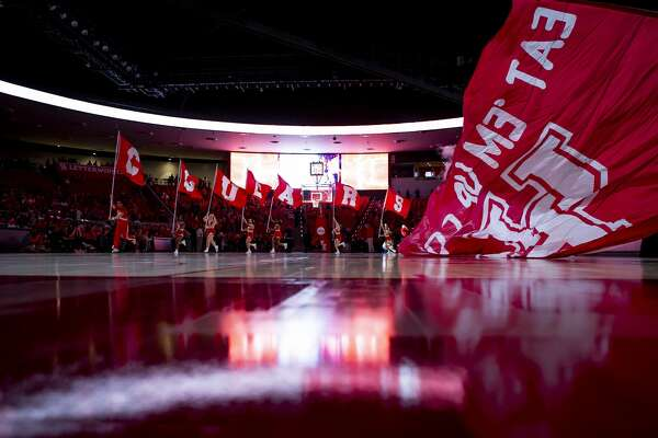 Cheerleaders at the University of Houston run with banners during the introductions for the Cougars' mens basketball game against the Southern Methodist University Mustangs at the Fertitta Center in Houston, Wednesday, Jan. 15, 2020.